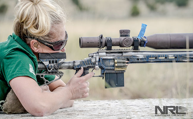 Women pulling trigger during National Rifle League competition.